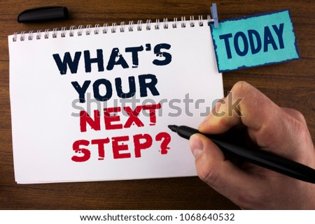 Handwriting text writing What iS Your Next Step Question. Concept meaning Analyse ask yourself before taking decisions written by Man on Notepad holding Marker on wooden background Today Clip.