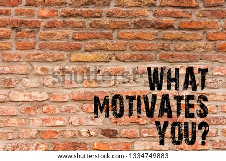 Handwriting text writing What Motivates Youquestion. Concept meaning Passion Drive Incentive Dream Aspiration Brick Wall art like Graffiti motivational call written on the wall.