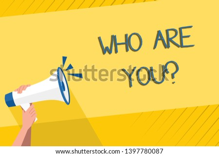 Handwriting text writing Who Are You question. Concept meaning asking demonstrating identity or demonstratingal information Human Hand Holding Tightly a Megaphone with Sound Icon and Blank Text Space.