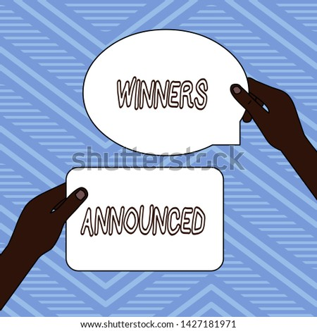 Handwriting text writing Winners Announced. Concept meaning Announcing who won the contest or any competition Two Blank Figured Tablets Signs Held in Hands One Above Other Text Space.