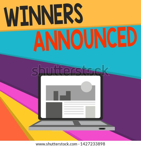 Handwriting text writing Winners Announced. Concept meaning Announcing who won the contest or any competition Open Modern Laptop Switched On with Website Homepage on Screen Web Search.