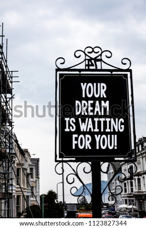 Handwriting text writing Your Dream Is Waiting For You. Concept meaning Goal Objective Intention Target Yearning Plan Vintage black board white letters words cloudy background old city ideas. #1123827344