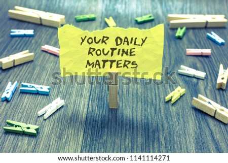 Handwriting text Your Daily Routine Matters.. Concept meaning Have good habits to live a healthy life Paperclip hold written torn page many clips laid on bluish wooden floor.