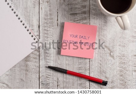Handwriting text Your Daily Routine Matters. Concept meaning practice of regularly doing things in fixed order Stationary placed next to a cup of black coffee above the wooden table.