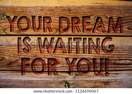 Handwriting text Your Dream Is Waiting For You. Concept meaning Goal Objective Intention Target Yearning Plan Wooden background vintage wood board wild message ideas intentions thoughts. #1126696067
