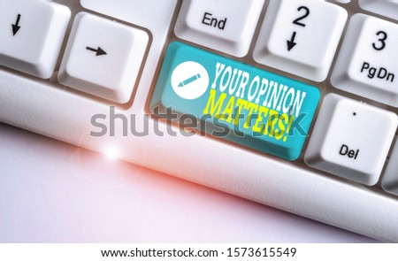 Handwriting text Your Opinion Matters. Concept meaning show you do not agree with something that just been said White pc keyboard with empty note paper above white background key copy space.