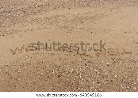 "Handwriting  words ""WELL WELL WELL"" on sand of beach. #643545166"