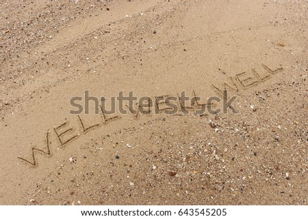 "Handwriting  words ""WELL WELL WELL"" on sand of beach. #643545205"