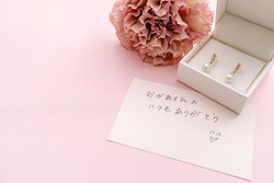 Handwritten message and present for mother on Mother's Day. Non English text in Japanese is