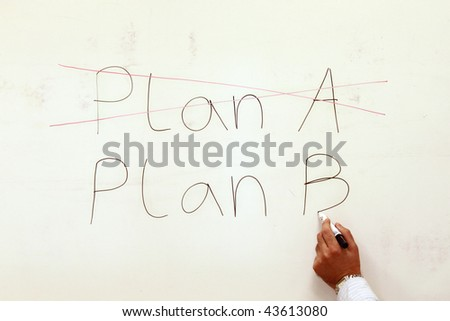 Handwritten plan a, plan b on whiteboard.