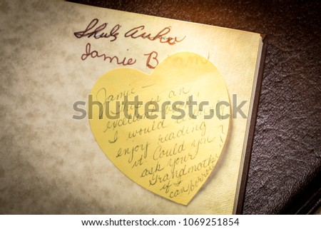 Handwritten post it note asking to borrow a book found inside the cover of a vintage volume. #1069251854