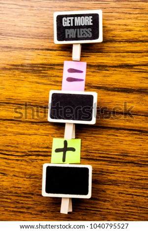 Handwritten text showing Get More Pay Less. Business concept for Budget Slogan Concept Written on clips, wooden background equation sign with plus. For your text.