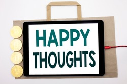 Handwritten text showing Happy Thoughts. Business concept writing for Happiness Thinking Good Written on shopping bag and tablet white background, tablet charging with cryptocurrency bitcoin.