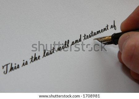 Handwritten 'This is the last will and testament of' with hand holding fountain pen