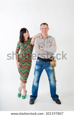 Handy man with tool belt, and woman