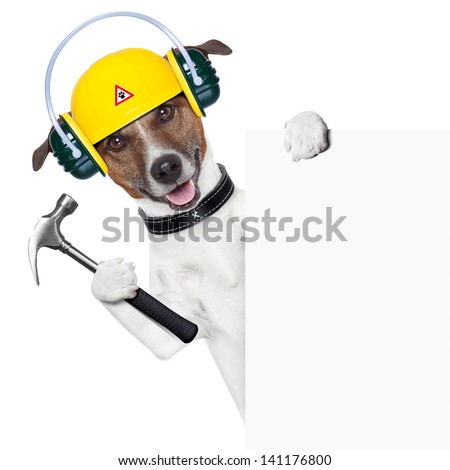 handyman dog with a hammer behind a banner