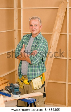 Handyman mature professional diy working on new home improvement