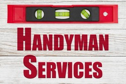 Handyman Services word message with red and black level on distressed whitewash