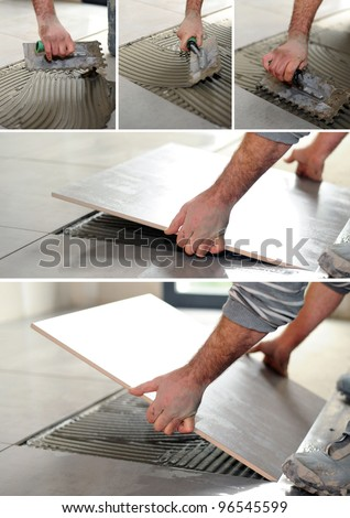 handyman spreading glue on the floor