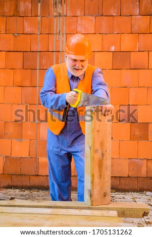 Handyman with hand-saw. Carpentry work. Builder worker carpenter handyman with saw. Construction worker sawing with hand saw. Wood sawing with handsaw. Carpentry service. Builder Sawing with hand saw.