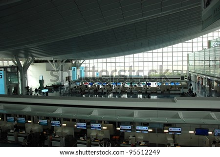 HANEDA, JAPAN -NOV 14, 2011: After the earthquake and nuclear disaster, the Japanese government asked to save power in Kanto. Tokyo International (Haneda) Airport is unusually dark in Nov. 14, 2011.