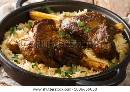 Haneeth is a slow roasted lamb dish from Yemen served on a plate of rice closeup on the table. horizontal Stock fotó ©