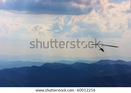 Hang glider flying in the mountains in Italy