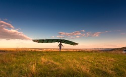 Hang glider on takeoff line before the flight.