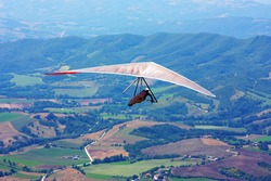 hang-glider taking of in the flight taken in Italy, Monte Cucco