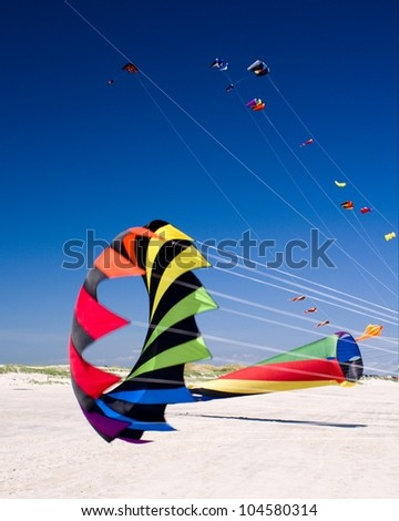 hang gliders with blue sky background