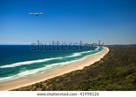 Hang Gliding along the coast of Byron Bay - stock photo