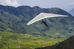 Hang gliding in Swiss Alps, Switzerland, Europe