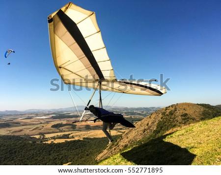 hang-gliding launching #552771895