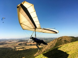 hang gliding launching in beautiful sunny day