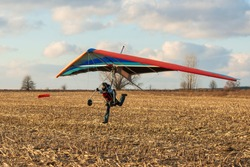 Hang gliding student runs fast with her wing. Learn to fly.