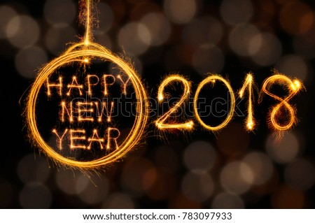 Hang Happy new year text in ball and 2018 written with sparkle fireworks on gold bokeh background #783097933
