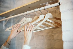 hanger in hand, wardrobe with hangers, place to hang clothes, empty hanger in hand, concept of order, rhythm, home comfort