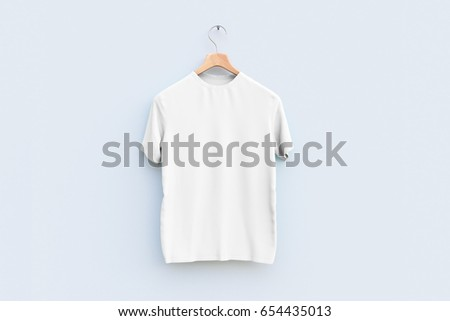 Shutterstock Hanger with empty white t-shirt hanging on wooden wall. Ad concept