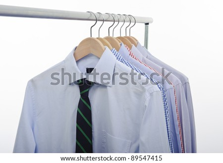 hanger with shirts and necktie isolated on white background