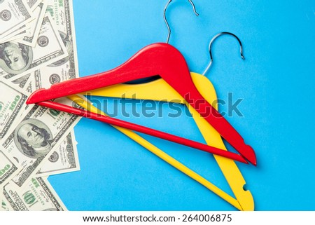 hangers and dollars near paper on blue background #264006875