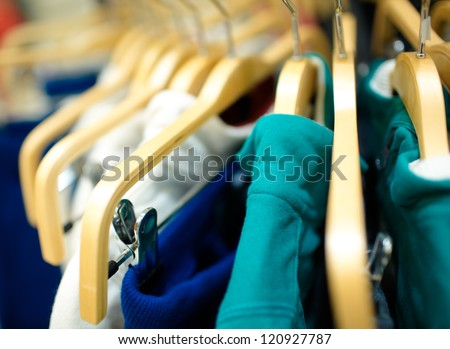 Hangers in the clothes store. Shallow dof.