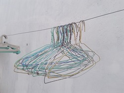 Hangers on the clothesline for drying clothes.