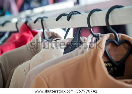 Hangers with outerwear. - Shutterstock ID 567990742