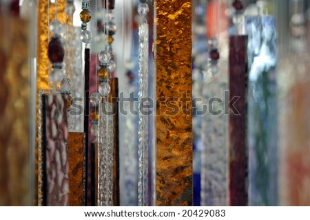 Hanging abstract glass peaces in different colors.