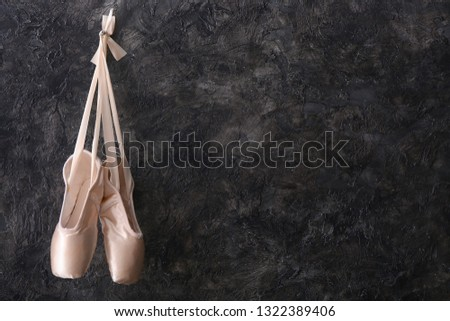 afacf386a496 Hanging ballet shoes on dark wall