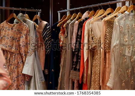 Hanging beautiful indian dresses different colors and decoration at market, shop, boutique, bazaar, fashion clothes designer collection Сток-фото ©