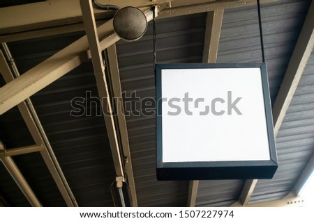 hanging blank advertising billboard or light box showcase on wall at airport or subway train station, copy space for your text message or media content, advertisement, commercial and marketing concept