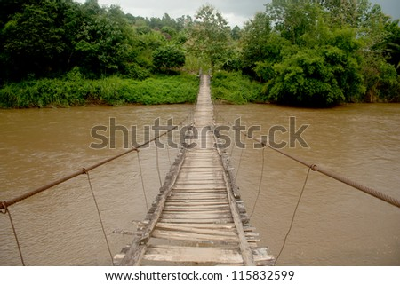 Hanging bridge across river in Chieng Mai Province,Northern of Thailand.