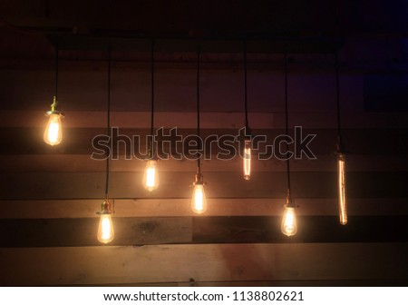 Hanging bulbs lights against restored barnyard wood.