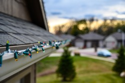 Hanging Christmas lights on gutter with plastic clips